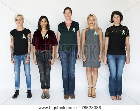 Group of Diverse People with Green Ribbon Represent Organ Donation