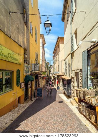 Antibes, France - June 29, 2016: day view of typical narrow street in Antibes France. Antibes is a popular seaside town in the heart of the Cote d'Azur.
