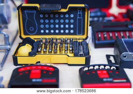 Pocket precision screwdriver set in box. Selective focus.