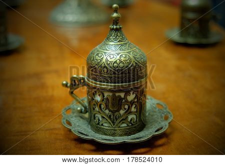 Ancient oriental tea holder decorated with ornaments