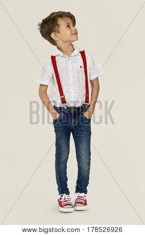 A Caucasian Boy Standing Looking Up Background Studio Portrait