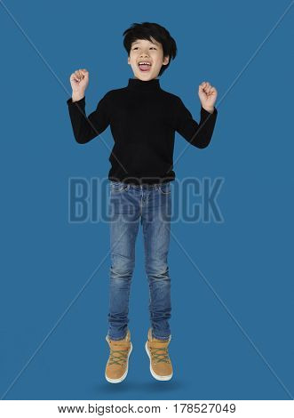 A happiness boy is jumping