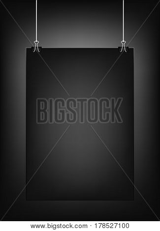Black vertical poster template hanging on clips, isolated on a black background. Poster realistic mokcup on a wall .