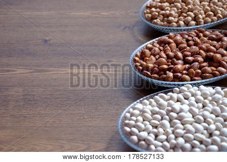Mixed pulses on the table in the Bowl: Dried beans, chickpeas and red beans