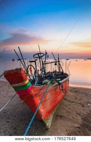 Small fishing boat used as a vehicle for finding fish in the sea.at sunset