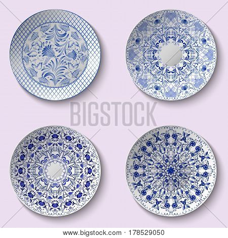 Set of decorative porcelain dishes with blue ethnic pattern in the style of Chinese painting on porcelain. Vector illustration