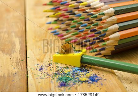 Sharp Pencils On A Wooden Background