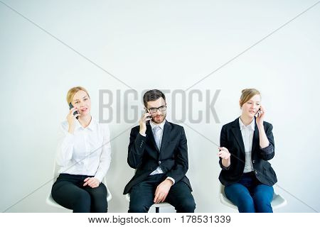 Three candidates are preparing for a job interview