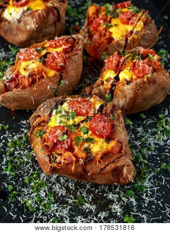 hot baked sweet potato stuffed with bacon, cheddar cheese, cherry tomatoes, balsamic vinegar, cress salad and parmesan sprinkle. Tacco, burrito style