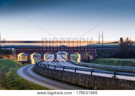 Railway bridge over road in Tuscany Italy