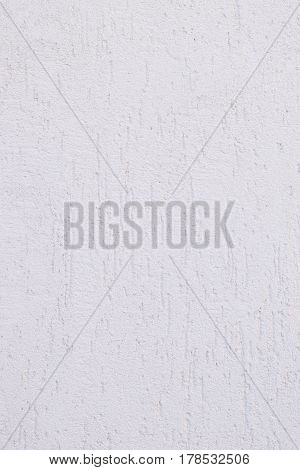 White wall with a decorative coating bark. Decorative coating on the basis of cement.