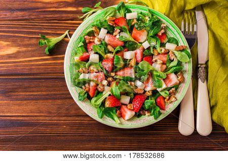 Salad With Strawberry, Spinach, Walnuts And Goat Cheese