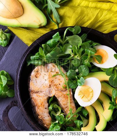 Grilled Sheatfish Fish Steak With Avocado, Arugula And Salad