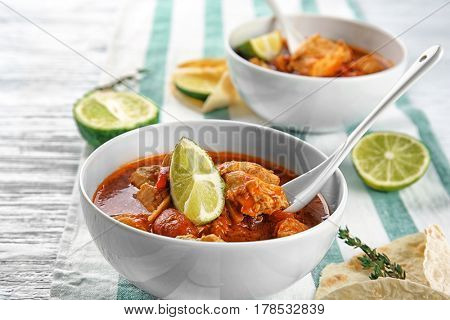 Portions of chicken tikka masala in white bowl on table