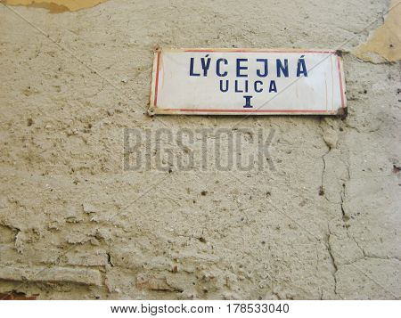 Street sign in old town of Bratislava, capital of Slovakia, eastern Europe. Isolated on retro vintage house facade wall light brown stone background