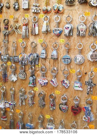 BRATISLAVA, SLOVAKIA - AUGUST 12, 2016: Showcase with different keychains in local market in Bratislava Slovakia. Popular shopping souvenirs with city views and symbols located in city center street.
