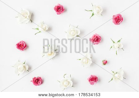 Flowers composition. Pattern made of fresh rose flowers. Flat lay top view