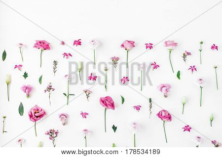 Flowers composition. Pattern made of various pink flowers on white background. Flat lay top view