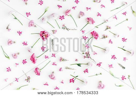 Flowers composition. Frame made of various pink flowers on white background. Flat lay top view