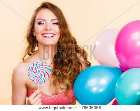 Woman Holds Lollipop Candy And Balloons
