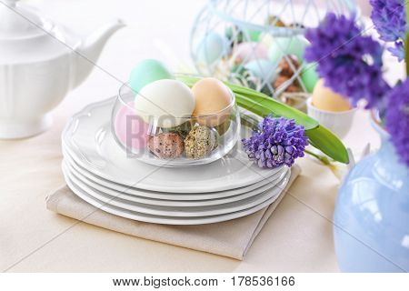 Beautiful Easter table setting  on linen tablecloth