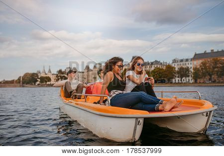 Young People Enjoying Boat Ride In The Lake