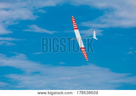 RC remotely controlled soaring plane model sailplane on blue sky in brisk wind