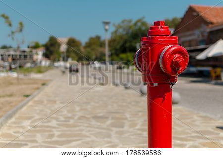 red fire hydrant in the street on blurred background