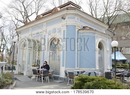 GRAZ, AUSTRIA - MARCH 20, 2017: Woman having a coffee at Opera pavilion in Graz Styria Austria.