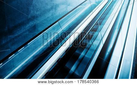 Moving staircase escalator as modern business or architecture background