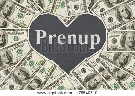 Money and marriage message One hundred dollar bill in the shape of a heart with a chalkboard heart with text Prenup
