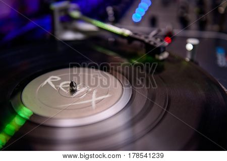 Turntable Playing Vinyl Close Up With Needle On The Record With Coloured Light Background. Selective