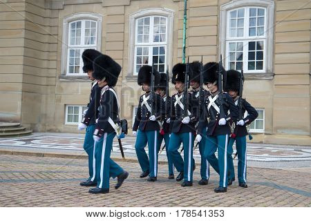 COPENHAGEN, DENMARK - NOVEMBER 03, 2014: Marching Royal guards. The divorce of the guard at Amalienborg Palace