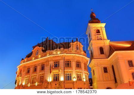 Main Council house illuminated at night in Sibiu town, Romania