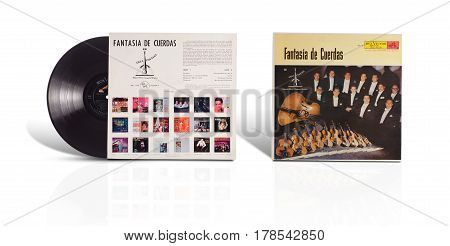 Rishon LeZion Israel-August 12 2016: Old vinyl mono album Fantasia de Cuerdas en Villa Fontana. This LP was manufactured in Mexico by RCA Victor Mexicana. Covers and vinyl disc are shooted on white background