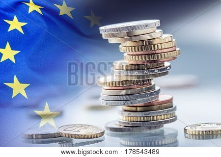 Euro money.Euro Flag.Euro currency.Coins stacked on each other in different positions. European union flag.