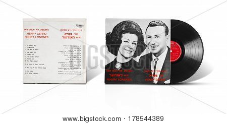 Rishon LeZion Israel-August 31 2016: Old vinyl mono album Zait Mich Nit Mekane. Rosita Londner and Henry Gerro. Compilation of 12 songs in Yiddish. Israeli label Makolit. Covers and vinyl disc are shooted on white background