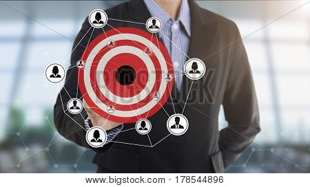 Businessman pressing button marketing goals on virtual screen. concept setting target vision.