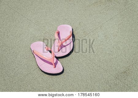 Abstract pink shoes on beach and sand vacation and holiday concept with copy space