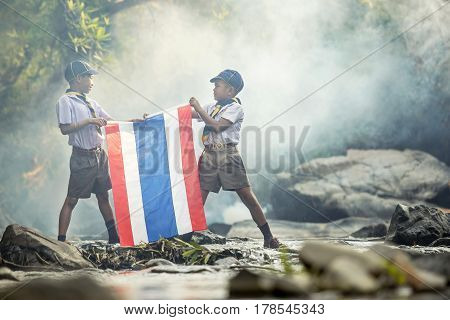 Adventure scout hold a flag team in the camping