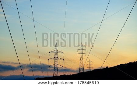 High voltage lines and electric towers background
