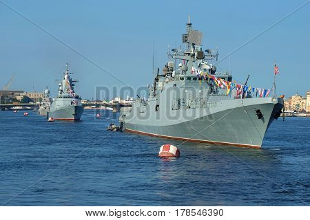 SAINT PETERSBURG, RUSSIA - JULY 28, 2016: Warships of the Baltic fleet of the Russian Navy in the waters of the Neva. Navy day in St. Petersburg