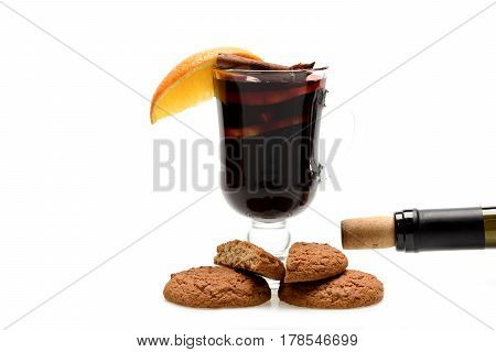 Glass Of Red Mulled Wine With Cookies And Bottle