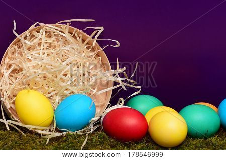Painted Easter Colorful Eggs In Wooden Box On Violet Background