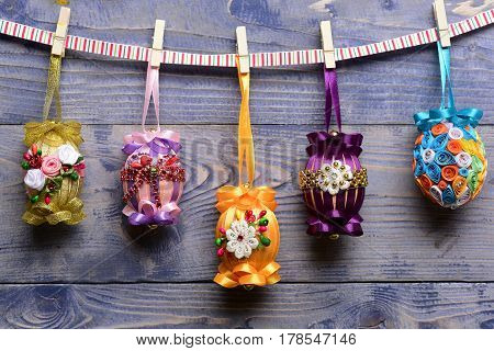 Easter Colorful Eggs Decorated With Thread, Beads Hanging On Clothespin