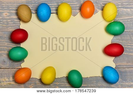 Set With Colorful Eggs On Burnt Paper . Happy Easter Concept
