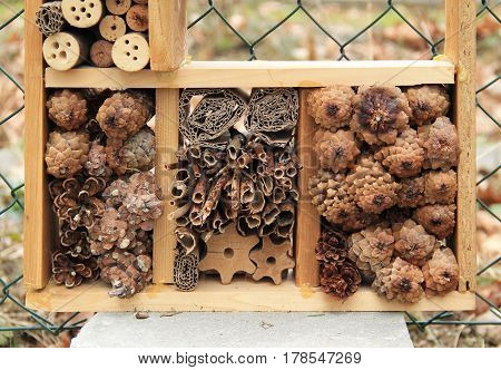 detail of insect hotel for small invertebrates with various material
