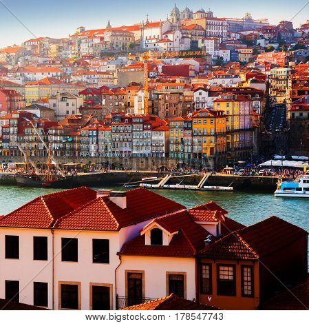 Tiled roofs in Porto. The Douro River. Summer city landscape.