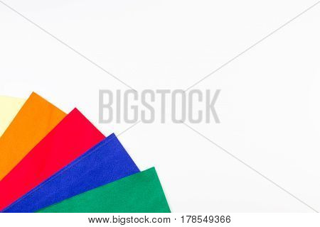 Selection of colorful felt sheets on white background. Top view