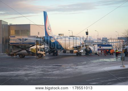 ST. PETERSBURG, RUSSIA - JANUARY 07, 2017: Preparation for a departure of the Airbus A320-214 (VQ-BDJ) on the Pulkovo airport in the January evening